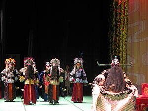 Judge Bao fiction - A Peking opera performance featuring Bao Zheng (seated) and his officers to his back.