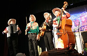 Riders in the Sky (band) - Riders in the Sky appearing at the Ponca Theatre in Ponca City, Oklahoma on September 29, 2007 at a concert commemorating the 100th anniversary of the birth of Gene Autry. From left to right are Joey the Cow Polka King, Woody Paul, Ranger Doug and Too Slim.