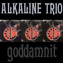 "A black album cover is divided into three horizontal portions: The upper portion displays the band's name, ""Alkaline Trio"", in stylized letters. The lower portion displays the album's title, ""Goddamnit"", in the same lettering. The center area displays three identical photographs of an analog alarm clock with the hands at 6:00. The clocks have been tinted red."