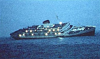 SS Andrea Doria - SS Andrea Doria the morning after the collision with the MS Stockholm in fog off Nantucket Island: The hole in her starboard side from the collision with Stockholm is visible near the waterline about one-third aft of the bow.