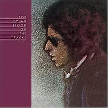 A drawing of Dylan's face in profile facing a purple stripe with the album's name in white