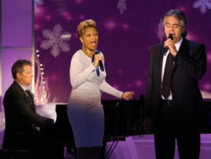 "My Christmas - Andrea Bocelli and Mary J. Blige performing ""What Child Is This"" on The Oprah Winfrey Show, while David Foster plays the piano, in November 2009."