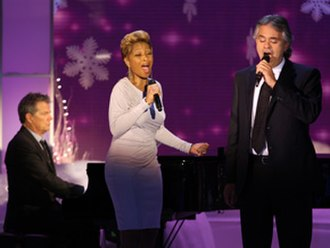 """My Christmas - Andrea Bocelli and Mary J. Blige performing """"What Child Is This"""" on The Oprah Winfrey Show, while David Foster plays the piano, in November 2009."""