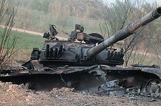 Battle of Najaf (2003) - Destroyed Iraqi Asad Babil tank on Highway 9 outside Najaf