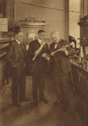 George F. Morrison - George in the GE research laboratory with Dr. Irving Langmuir and Thomas Edison examining a vacuum tube.