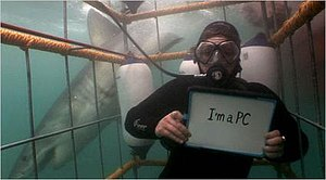 I'm a PC - An unidentified woman revealing herself as a PC user while underwater in a shark cage