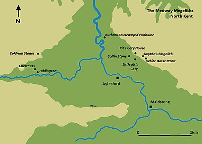 A map featuring a river moving from the top of the image (north) to the bottom right corner (southeast). Various black dots mark out the location of Medway Megaliths on either side of the river.
