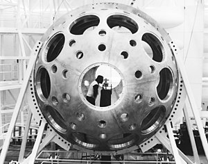 The Nova laser target chamber during alignment and initial installation (ca. early 1980s). Some of the larger diameter holes hold various measurement devices, which are designed to a standard size to fit into these ports while others are used as beam ports.