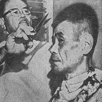 Shoichi Yokoi - This newspaper photograph was described as Yokoi's first haircut in 28 years.