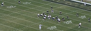 Triple option - The Paul Johnson-concocted version of the triple option using a quarterback, two slotbacks, a fullback, and two wide receivers, known as the flexbone formation. Here, Navy is running the offense against Army in the 2008 Army–Navy Game.