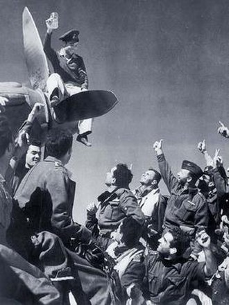 335th Squadron (HAF) - Members of the squadron celebrating the successful bombing of the Italian XX Corps headquarters, Oct. 28, 1942.