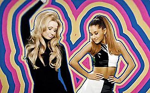 Problem (song) - Grande and Azalea in a colorful backdrop during the music video which incorporates elements from 1960s art.