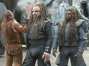 Battlefield Earth (film) - Scene from Battlefield Earth, showing (left to right) Barry Pepper, John Travolta and Forest Whitaker in costume.