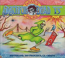 A skeleton wearing a green, hooded robe is ice skating, with the Golden Gate Bridge in the background