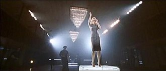 """Mercy (Duffy song) - The main version of """"Mercy"""" shows Duffy standing on top of a platform inside a large hall whilst men dance around her."""