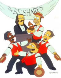 Four barbershop quartet singers, with one handing an award to a mustached man in a suit.