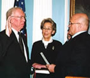 H. Douglas Barclay - Being sworn-in as ambassador by Deputy Sec. of State Richard Armitage as his wife Dee Dee looks on. November 12, 2003.