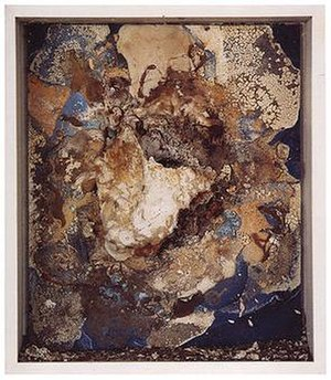 Dieter Roth - Insel, 1968; foodstuffs, including yoghurt, and screw and wire on blue panel, covered in plaster and left to rot.