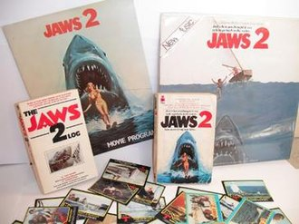 Jaws 2 - A selection of merchandise from Jaws 2. Top: Movie Program; Soundtrack LP Album, Middle: The Jaws 2 Log by Ray Loynd; Jaws 2 novelization by Hank Searls, Bottom: A selection of trading cards