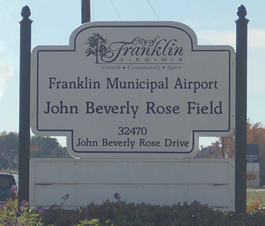The Franklin Airport sign with the International Paper paper mill in the background KFKN airport sign.JPG