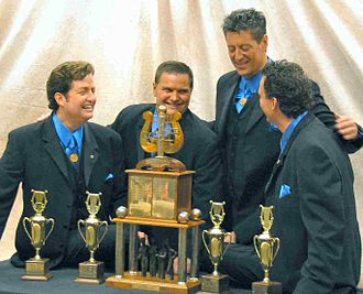 Barbershop quartet - Max Q, winners of the Barbershop Harmony Society's international barbershop convention in Denver, Colorado, 2007. From left to right: Greg Clancy (tenor), Tony DeRosa (lead), Jeff Oxley (bass) and Gary Lewis (baritone).