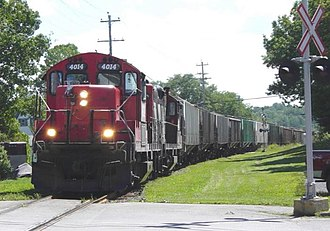 Windsor and Hantsport Railway - WHR freight train westbound with 13 carloads of grain, Hantsport, 22 Aug 2006.