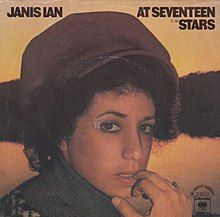 "An image of a woman smiling while looking to the right. She has large, curly hair. The words ""Janis Ian"", ""At Seventeen"" and ""Stars"" are placed over the image in varying font types and colors. Words about the record company are also included."
