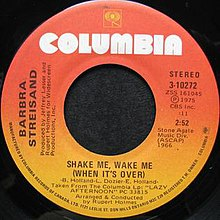 A red-orange vinyl record of the single appears