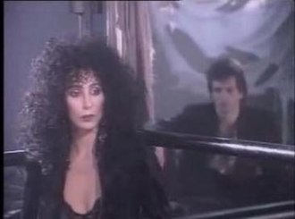 """We All Sleep Alone - Cher and Camiletti in the """"We All Sleep Alone"""" video."""