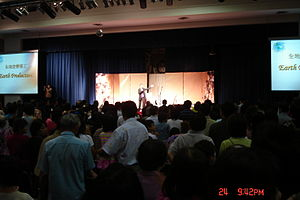 Dr. Yap Giving Invitation at an Evangelistic M...