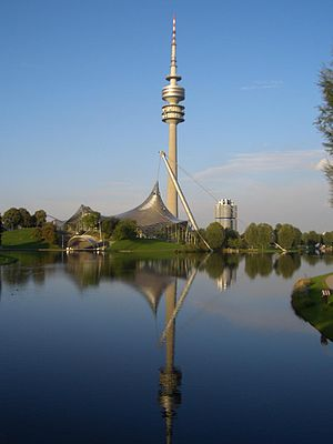 Olympiapark (Munich) - General view of the Schwimmhalle, park, pond and communication tower