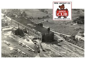 Piper Aircraft - Piper Aircraft Company factory in Lock Haven, Pennsylvania, with the Piper Cub logo superimposed at the top