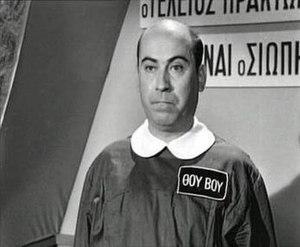 "Thanasis Veggos - Thanasis Veggos as ""000"" (secret agent ""007"" spoof) in ""Faneros Praktor 000"" (1967)"