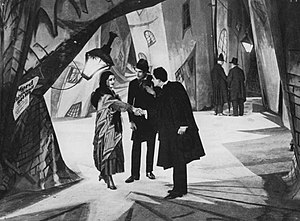 Mise-en-scène - The distinctive mise-en-scène of The Cabinet of Dr. Caligari (Germany, 1920) features stark lighting and jagged architecture