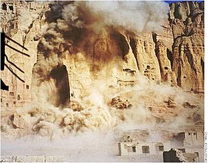 Photograph of a statue being destroyed with dynamite on March 21, 2001.