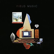 "A black square with the words ""Field Music"" in grey text at the top. Beneath the text is a graphic, in the center of whcih is a television inside a box with a large triangle resting atop of it. Beneath the television is a brown patterned carpet with pillows and pieces of cloth scattered around it. To the right of the television is a blue chair and a brown door. Above the door is the shape of white arrow pointing downward, with the words Open Here in black text within it. Above and to the right of the television is a window, through which an outdoor view and distant buildings are visible."