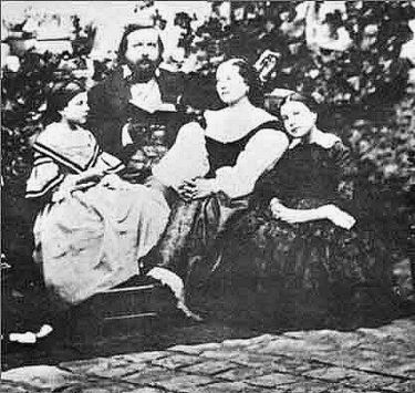 Theophile Gautier, his wife Ernestina Grisi-Gautier and their daughters Estelle and Judith. Photograph taken around 1857. Gautierfamily.jpg
