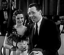 Julie Bishop and Ray Walker, in The Loudspeaker (1934).jpg