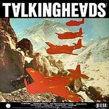 Album cover containing a drawing of a mountain range and four mostly red warplanes flying in formation. There is green text on the left hand side and a barcode in the top right corner.