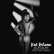 "A black and white photo of a naked woman with her back to the camera. She has a long ponytail that covers her butt with the words ""Kat DeLuna"" in a bold white font and the words ""BUM BUM FEAT. TREY SONGZ"" in a faint white font in the lower right-hand corner."