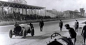 Riding mechanic - Driver Ralph DePalma and riding mechanic Rupert Jeffkins, pushing the Mercedes down the main straightaway at the conclusion of the 1912 500-Mile Race.