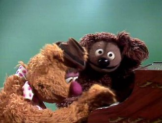 "The Muppet Show - Fozzie Bear (left) and Rowlf the Dog (right) perform ""English Country Garden"" on episode 2.18 of The Muppet Show"