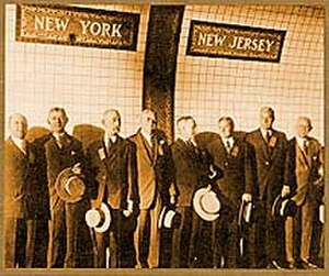 New Jersey in the 20th century - People standing on the New Jersey-New York border in the newly constructed Holland Tunnel.