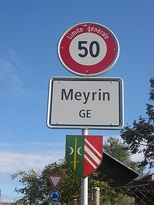 Meyrin - This sign at the western edge of Meyrin features the coat of arms of the community.