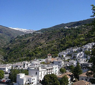Alpujarras - The three villages of the Poqueira valley: Pampaneira, Bubión, Capileira with the Sierra Nevada in the background.