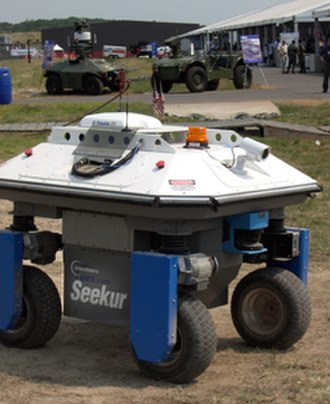 Autonomous robot - The Seekur and MDARS robots demonstrate their autonomous navigation and security capabilities at an airbase.