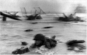The Magnificent Eleven - American GI moving toward Omaha Beach taken by Capa