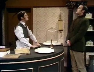 Cheese Shop sketch - Michael Palin (left) and John Cleese (right) of Monty Python performing the Cheese Shop sketch.