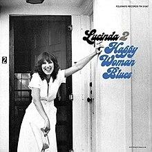 220px-Happy_Woman_Blues.jpg