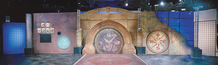 Panorama of the MoneyHunt set, featuring the clock, compass, and coin motif.